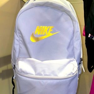 White and gold Nike backpack